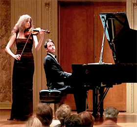 photo of violinist and pianist performing