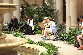 adults sketching in the Garden Court of The Frick Collection, with fountain in foreground