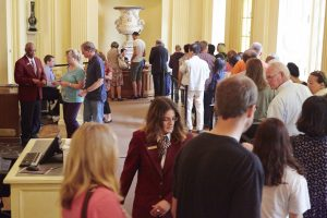 Reception Hall with visitors on line for tickets